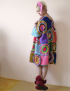 wear over balloon pants or  long full skirting.. beneath the top, wear a cowlneck that compliments the pants and one color from top. lose the head rag , and boots... wear with sandals or ballerina flats