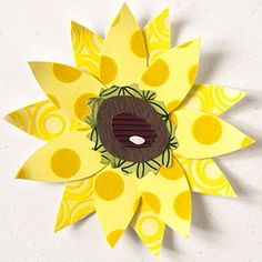 DIY Sunflower: Sunflower Paper-Piecing Pattern Design by Vicki Boutin Cut shapes from flocked, corrugated, and metallic papers to give a sunflower paper piecing extra texture. Get the list of sources used in this project.  SOURCES Cardstock: Prism Papers. Decorative paper: BoBunny Press (flocked dot), Chatterbox (green metallic, flocked ring), WorldWin Papers (corrugated).