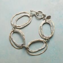 This pretty piece with sterling and 14kt gold-filled ovals is the classic chain link bracelet reimagined.