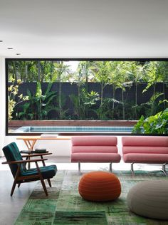 DM House is a private residence designed by Studio Guilherme Torres. Completed in 2012 with a vibrant interior, it is located in São Paulo, Brazil.
