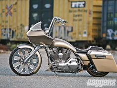 Here's an '06 Road Glide that at first glance looks not far off from stock, but once you start scrutinizing it , you'll see all the extensive and cool mods.