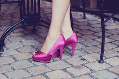 Pink peep-toe pumps.
