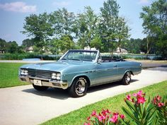 1965 Buick Skylark Convertible owned one like this car when i was 16.same color ,had et mags on it ,I painted them blue.1969.to be 16 again.