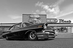 A 1957 Chevy at the diner, a great American muscle car of the eighties. #musclecars #americanmuscle #coolcars #chevrolet #chevy