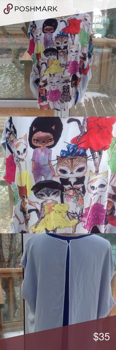 """🆕😻😻""""Cats"""" shirt Get your """"Cats On"""" with this tunic. Cats are all over the front of this top. Sleeveless with a blue sheet back with white overlay. I believe it's a large.  I bought it for a beach coverlet and it's a bit roomy for me La Chapelle Sport Tops"""