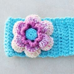A crocheted ear warmer with a giant flower is simple to make and looks great