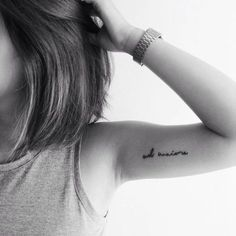 """""""Ad maiora"""", Latin for """"toward great things"""" on Allere Kaye's left inner arm."""