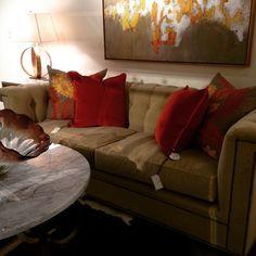 Spicy orange pillows and caramel velvet sofa for a cozy summer read.  @hickorychair #hickorychair #summer #read #cozy #companyc #blissstudio #lovelocal #shoplocal  #interiordesign #interiordecor #westendinteriors