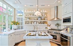 Love the bright kitchen, detail on the ceiling, cabinets, white backsplash and marble counters