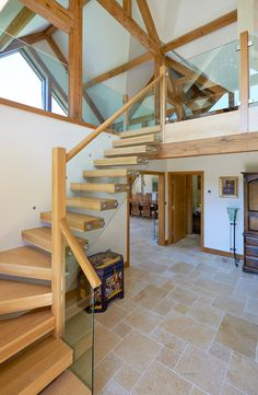 View of the contemporary cantilevered Oak staircase with glass balustrading.