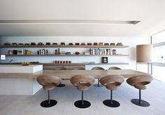 | KITCHENS |  INTERIORS | heart the shelving & cantilevered countertop / dining table ... not so much the chairs #interiors