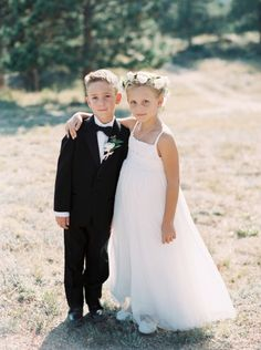 These two cuties: http://www.stylemepretty.com/2015/07/17/elegant-summer-wedding-at-the-stanley-hotel/ | Photography: Sarah Joelle - http://www.sarahjoellephotography.com/