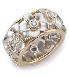 "18ct White & Yellow Gold Diamond Dress Ring      ""Frangipani"" design features eight flowers, each with a rub over set round brilliant cut diamond.    Suits diamonds from 0.05ct.    Can also be made in platinum, white or yellow gold."