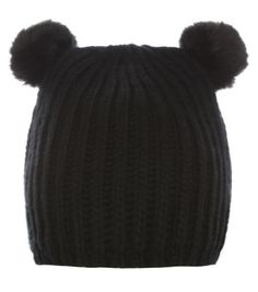 2973177a68579 Put a cute twist on your urban street style with this pom pom ears beanie.