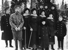 On the grounds of Tsarskoe Selo. From left to right: an officer attending on the Emperor, Nicholas II, Grand Duchess Tatiana, Grand Duchess Olga, Grand Duchess Marie, Grand Duchess Anastasia and Tsarevich Alexei. The three boys behind them are Prince Nikita, Prince Rostislav, Prince Dmitri and standing in front of his female cousins is Prince Vasili Alexandrovich, sons of the Emperor's eldest sister Grand Duchess Xenia Alexandrovna.