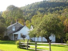 Gorgeous stone farm house sits on over 100 acres on a quiet country road not far from the Ferry to Vermont