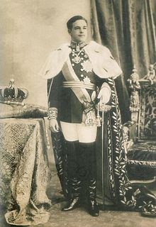 """Dom Manuel II(1889–1932)was the last King of Portugal, """"the Patriot"""" or """"the Unfortunate"""" ascending the throne after the assassination of his father, King Carlos I of Portugal, and his elder brother, Luís Filipe. His reign ended with the 5 October 1910 revolution, and Manuel lived the rest of his life in an exile enforced by the new Portuguese First Republic. He died unexpectedly and The Portuguese government, at that time ruled by Salazar, authorized his burial in Lisbon, after a state…"""