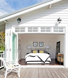 Bedroom with folded open doors. Oh to nap here!