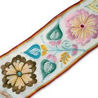"""blind trim?  3"""" Hand Embroidered RibbonStyle:31490    Measures approx. 75MM  This hand made decorative cotton ribbon features an ethnic embroidered floral pattern with embroidered edges. Great for garments, belts, décor, and much more.   Made in India"""