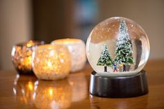 Introducing the World's First Diamond Christmas Snow Globe! Featuring a bespoke sculpture of your family and real diamonds within the snow!