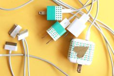 Washi tape is used to decorate these iPhone chargers. Awesome & Easy DIY project.