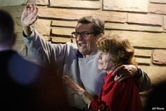 PENN STATE – PATERNO – Giving Thanks. Paterno and his wife, Sue, stand on their porch to thank supporters gathered outside their home on the night he is fired.