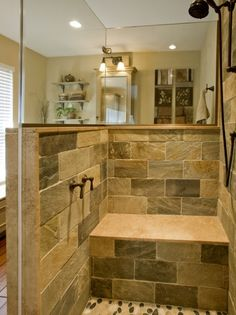 Nice shower with duel heads, bench, mirrors