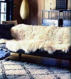 Image result for sofa with sheepskin