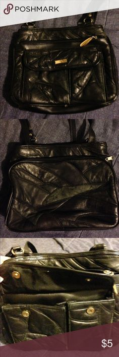 Black bag with lots of pockets This bag has a zipper pocket in the front & 2 pockets with a zipper pocket. And on the back it has another big zipper pocket. It has a little wear, but has plenty of life left. Not leather. Bags Shoulder Bags