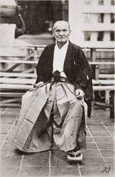 Sokaku Takeda (1859-1943), disseminator of Daito-ryu aikijujutsu and the main teacher of Morihei Ueshiba, poses in Osaka in 1939