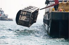 NYC 'retired' old subway trains into the ocean as a reef rebuilding project. Shoots of subway trains being dropped into the ocean is amazing.