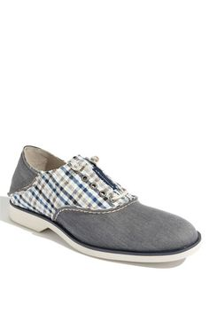 A canvas oxford pays homage to the classic saddle shoe and features signature rawhide laces.  Removable insole.  Canvas upper/fabric lining/rubber sole.  By Sperry Top-Sider®; imported.  Men's Shoes.