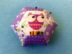 Cute hexie pincushion by Sarah at Pings and Needles--love the fussy cut owl!