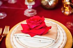 A red rose was placed on each plate at this Disney's Fairy Tale Wedding inspired by Beauty and the Beast
