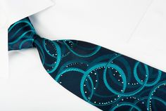 Stylish silk Rhinestone necktie perfect for any occasion handmade and designed by top brand name Mila Schon. Presenting an elegant design with turquoise ovals on dark turquoise woven silk, sparkling with Rhinestones.