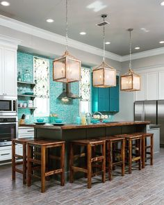 A teal cabinet and counter-to-ceiling glass tile in a similar hue provides a beachy vibe for this otherwise-neutral kitchen. The designer used her budget wisely to add upgrades such as two sinks, a built-in icemaker and the glass tiles. Decor, Kitchen Design Decor, Beach House Kitchens, Kitchen Design Pictures, Kitchen Cabinets Decor, House Design Kitchen, Teal Kitchen, Bathroom Decor, Small Kitchen Decor