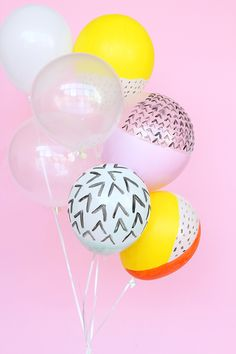 painted balloons on pink background