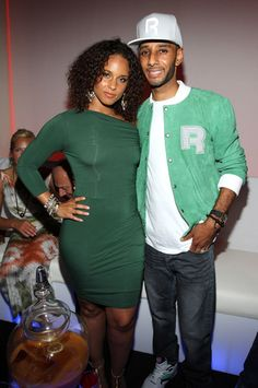 Alicia Keys with her husband in green.
