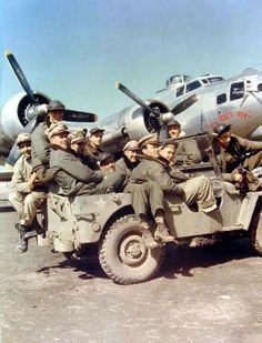 """Crew of B-17G Fortress """"I'll Get By"""" arrive at their airplane by Jeep ay RAF Horham, Suffolk, England, UK; 1944."""