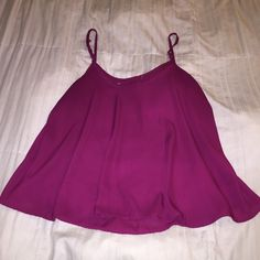 Maroon chiffon blouse Worn lightly, size tag came off when washing. Adjustable straps. Size XL but can fit a Large. Slightly higher in the front and slightly longer in the back. Tops Tank Tops