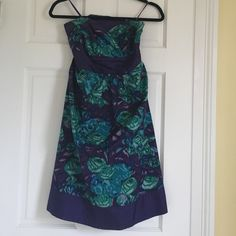 Worn once - Anthropologie Moulinette Soeurs Dress Worn once to a wedding. Beautiful jewel tones watercolor flower print. A bit stretchy in the back as shown to accommodate a few sizes. Only damage I notice is that the tag is only seen on in one corner! Anthropologie Dresses