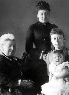 A rare photograph showing a smiling Victoria enjoying the company of her daughter Beatrice (standing) her granddaughter Victoria of Hesse (sitting) and her great-granddaughter Princess Alice of Battenberg. Little Alice went on to marry Andrew of Greece and Denmark and became the mother of Prince Philip, Duke of Edinburgh and consort of Queen Elizabeth II.