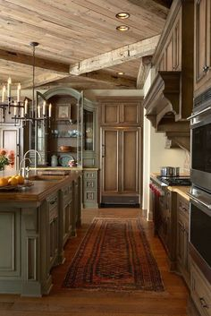 LOVE everything about this: wood color on cabinets, paint color, rug, and floors (not to mention the stove)