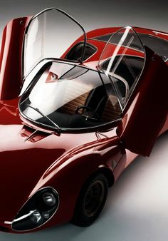 "About the Alfa Romeo Tipo 33 Stradale. What other word besides ""stunning"" could fittingly describe its delicate, beautiful lines?"