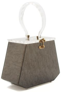 """This gray Lucite handbag with a carved floral handle and top is stamped """"Florida Handbags."""" From the estate of Norma Seidman, Lincolnwood, Illinois"""
