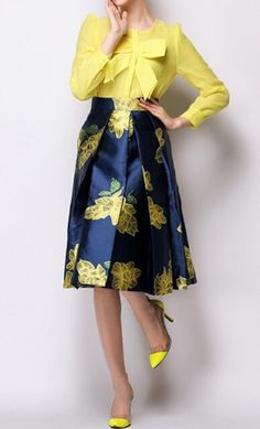 Womens high waist vintage style modest mid length skirt with bold floral print available in S-XL