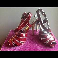 Red w/sliver trim BCBGirl heels Gorgeous Red heels trimmed in silver patent leather. Perfect condition. EZ to walk in. Worn 2 times & got plenty of compliments. BCBGirls Shoes Heels