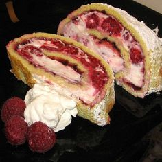 Makes 12 to 16 slices Hungarian Raspberry-Cream Roll or Malna Piskotatekercs  Prep Time: 20 minutes    Cook Time: 15 minutes    Total Time: 35 minutes    Ingredients:    1 recipe Hungarian Basic Sponge Cake (see below)  .  Filling:  1 (12-ounce) can raspberry filling  1 cup heavy whipping cream, whipped and refrigerated  1 (8-ounce) package softened cream cheese  1/2 cup granulated sugar  1 tablespoon vanilla  2 or 3 pints fresh raspberries, rinsed and air dryed  Confectioners' sugar
