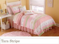 (a better shot of this pattern--subtler pink & green)  Tara's Stripe is a classic quilt horizontal stripe design with ribbon highlights and clean, tight floral patterns that let the pattern cover a wide age range.  The real quality of this pattern can only be seen up close, where the quilts comes alive with details. Each quilt has hand crafted ribbon appliqué flowers in a variety of colors to help it coordinate with a wide range of room colors. The quilt is 100% cotton face cloth with 100%…