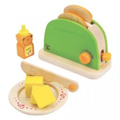 "Pop-Up Toaster- Rise and Shine! Make a quick breakfast with our Pop-Up Toaster! Complete with toaster, honey, butter, bread, plate, and ""knife"", this set is sure to inspire imagination and creativity. Toast can be inserted into toaster and popped up by hand using a lever on the side. Complements other Hape appliances and play food. Wood for this toy comes from an FSC-managed forest accented with water-based paint and is made to meet the strictest of safety standards."